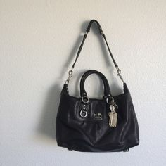 {COACH} Madison Sabrina Black Leather #12937 Authentic Coach bag of exterior black leather, silver hardware, and beautiful plum interior lining with one zip pocket and one open pocket. Also has 2 handles with a detachable shoulder strap. received from an ex so unfortunately it has to go! It has some creasing from storage but otherwise in perfect condition. I only used this for fancier occasions so it has been taken out less than 5 times. From a pet free smoke free home! Feel free to make an…
