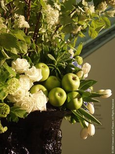 Green apples, white tulips and roses