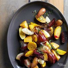 Roasted root vegetables - assorted root vegetables (carrots, parsnips, beets, fingerling or new potatoes, celery root, turnips, rutabagas and Jerusalem artichokes) and fresh herbs (thyme, parsley, dill, rosemary, and/or sage)