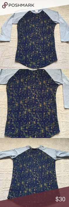 """LuLaRoe Randy baseball tee Perfect condition! Worn once. Super soft """"spun polyester"""" and spandex. 18"""" across chest. At longest length measurement flat, it is about  26.5 inches.  Heather gray sleeves with navy background and gold and hunter green accent colors. 3/4 sleeves LuLaRoe Tops"""