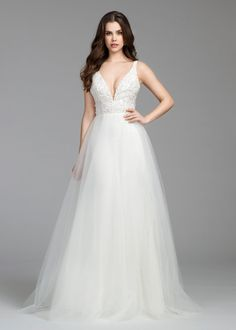 Style 2657 -  Ivory natural waist bridal ball gown, V neckline with encrusted floral beaded bodice, V back, sparkle tulle skirt with fitted trumpet underlay and chapel train.