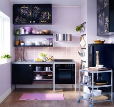 Inventive small kitchen...love the stencils on the cabinets...and the colours would fit with my pied-a-terre