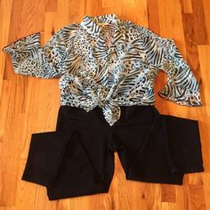 Animal Print Semi-Sheer Blouse Super cute and can be worn several different ways. Excellent Condition!!!  Medium and Light Blues with Black markings. A shell will be need to wear underneath. Button closure and ruffle cuff. Sweet!!! Nicola Tops Blouses