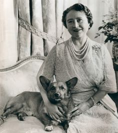A Sept. 4, 1960 photo of Queen Mother Elizabeth pictured on her 60th birthday with pet corgi named Billy. #corgi