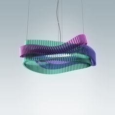 """Symphony lamp by Anna Strupinskaya.   """"The concept of the chandelier researches the connection between light and sound waves and their similarity. Light, color and sound are visualized in 3 interlaced spatial ribbons. They consist of light transparent tubes that symbolically represent the theme of musical instruments.""""   Photo CC BY-NC 3.0: Bēhance Inc."""