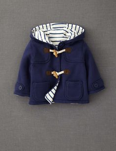 Like a mini Paddington Bear, but with the addition of some serious stripes: jersey duffle coat in navy or bottle green.