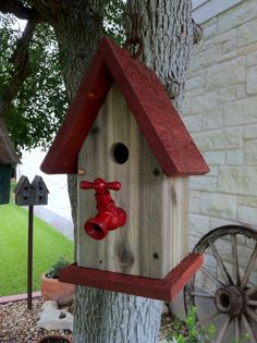 Red roof birdhouse....love the red faucet as a perch!