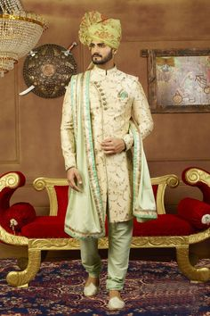 Ivory Sherwani with leaf-like patterns looks simple yet elegant. Also, the cross buttoning and use of aqua hue make the outfit look unique. Pairing the sherwani with light olive green churidar and shawl will make an excellent combination for your wedding. Sherwani For Men Wedding, Wedding Dresses Men Indian, Sherwani Groom, Wedding Dress Men, Backless Wedding, Indian Dresses, Indian Outfits, Indian Weddings, Wedding Groom