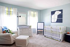 love love love the pieced jumbo dog silhouette canvases above the crib. and the lime green, navy, light grey-blue, and white color combo- still so fresh