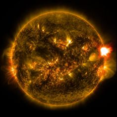 A solar flare, visible at the right of the image, occurs when magnetic field lines split apart and reconnect, far more rapidly than prior theories have predicted. Image credit: NASA.