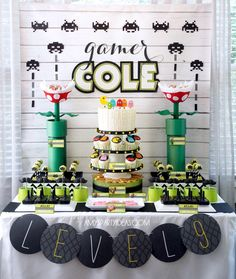 Ultimate Gaming Party: the backdrop and centerpieces are amazing! Vinyl backdrop that has a printed wood plank pattern + paper elements cut with the Silhouette machine + washi tape space invader tracks  {Amy's Party Ideas + Lulu Cole shop}