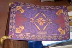 Aladdin Magic Carpet Mousepad with Tassels. This could make a great invitation if replicated on card stock with tassels.