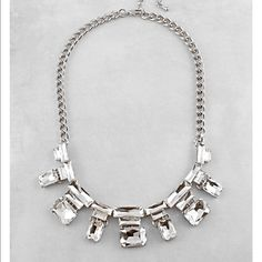 NEW Ice Ice Baby Statement Necklace Set Clear rhinestones set in silver metal create a multi-faceted statement necklace. Matching earrings are included . Lobster clasp closure and 17 inches in length. Jewelry Necklaces