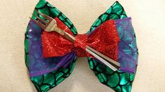 Little Mermaid inspired Bow- Ariel bow, scales, purple, red, fork, little mermaid, green, hand crafted, other options available, lanyard too by BowsbyMarthaMiami on Etsy https://www.etsy.com/listing/237698968/little-mermaid-inspired-bow-ariel-bow