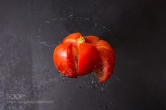 Pic: cut the tomato in the air