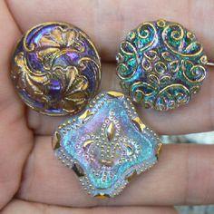 Three reverse iridescent Czech Republic glass buttons.  I love them!  http://www.vintagebuttons.net/ccglass9.html