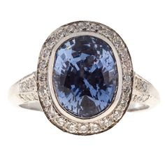 Peter Suchy Designs Oval Periwinkle Blue Sapphire Pave Diamond Platinum Ring | From a unique collection of vintage engagement rings at https://www.1stdibs.com/jewelry/rings/engagement-rings/