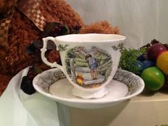"""Winnie the Pooh Cup and Saucer, """"Poohsticks"""" by Royal Doulton."""