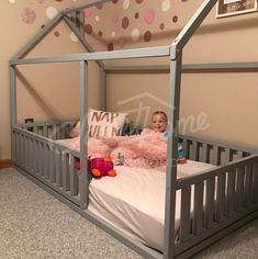 Pastel kids room with grey bed, toddler bed twin size, baby bed, children bed, montessori wooden house, nursery interior crib, toddler bedroom design, girl room, with fence