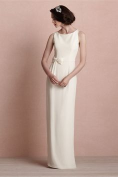 A classic silhouette, rendered in pure crepe de chine. The sophisticated contours of this Prehnite original are punctuated by a simple, feminine bow and a single gold button at back of collar. A Prehnite original, designed exclusively for BHLDN. Side zip with hook-and-eye closure. Professionally clean. Imported.