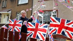 William Rattray puts up flags in his garden in Fallin, central Scotland ahead of the Jubilee celebrations this weekend, Friday, June 1, 2012. (AP / Andrew Milligan / PA Wire)