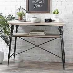 Traditional style meets modern farmhouse flair with this Industrial Fir Wood and Iron Console Table! You'll love the unique design of this striking table.