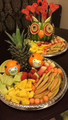 Homemade for our twin baby shower. Fruit tray owl and orange babies.