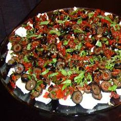 Best Ever Party Appetizer Recipe -- marinated goat cheese with sun dried tomatoes served with sliced french bread. Cheese Appetizers, Yummy Appetizers, Appetizers For Party, Appetizer Recipes, Tapas, Antipasto, Mezze, Great Recipes, Favorite Recipes