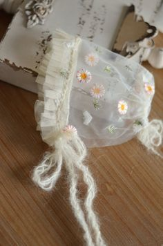 Beautiful embroidery tulle bonnet embellished with ruffled tulle and mohair ties Suitable for NB Hand wash Shipped in 5 business days Baby Boy Baptism Outfit, Make A Tie, Most Beautiful Dresses, Baby Bonnets, Newborn Outfits, Hand Embroidery Designs, Girl Doll Clothes, Baby Wearing, Baby Headbands