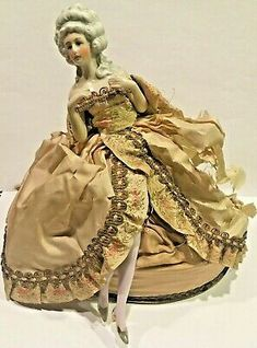 Powder box has half legs attached to the side of the powder box to give the illusion of a full doll sitting in a full dress atop a puffy chair. Half doll attached but slightly loose. Gold Powder, Half Dolls, 1920s Art Deco, Marie Antoinette, Antique Dolls, Porcelain, Legs, Antiques, Box