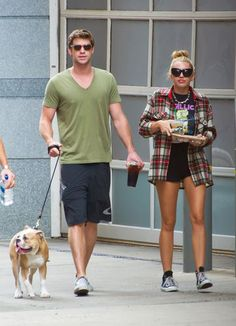 Liam Hemsworth & Miley Cyrus from Celebrity Pets: Miley Cyrus' Puppy, Taylor Swift's Cat & More The engaged couple took their furry friend Ziggy out for a coffee run in Philadelphia. Liam Hemsworth And Miley, Miley And Liam, Latest Celebrity News, Celebrity Gossip, Old Miley Cyrus, Divas, Taylor Swift Cat, Famous Couples, Famous Celebrity Couples