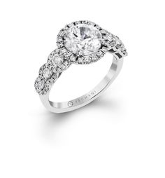 This stunning Delicate Diva collection engagement ring features .31 ctw of side stones leading to the center like a sparkling pathway, all surrounded by .37 ctw of smaller round white diamonds.