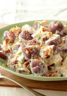 Steakhouse Potato Salad -- At the steak house even the potato salad means business, with hearty potatoes, bacon and all kinds of creamy. This side dish recipe is no different!