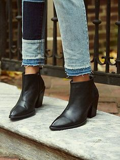 Entrance Ankle Boot | Beautifully crafted leather ankle boots featuring a pointy toe with distressed detailing.  Exposed side zip for an easy on/off.  Stacked heel.