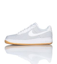 buy popular 37bf2 a064d NIKE Air Force One Low top sneaker Lace front closure Padded tongue with  NIKE swoosh logo Suede material Contrasting sole trim