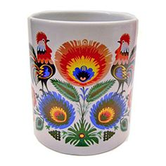 This very colorful folk design mug comes from the town of Lowicz, Poland.  The wrap-a-round scene features two roosters and a floral design....