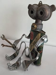 Assemblage Found Object Robot! Each bot is assembled with love. Comes with a birth certificate or authenticity. Guaranteed for life - we will fix or replace any parts damaged over time due to use, as they can be delicate at times. You pay shipping to from us. Bring a Bot Home