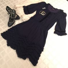 """12/24 HP !!! Theme navy dress PRECIOUS !! This is the cutest navy dress- fully lined, scalloped hem w small Ruffles at the bottom neck mid-front.  It also has velvet mid vertical strip in top front and at end sleeve detail.  There is an elasticized waistline 2"""".  Length 35"""" at longest part of hem.   Theme Dresses Midi"""