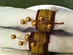 I made these Thanksgiving napkin rings using toilet paper roll, remnant fabric, ribbon, twine & gold sticks. Hot glue and use!!