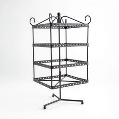 This rotating earring display can hold up to 96 pairs of earrings and is perfect for standing on a counter or cabinet. Display studs or dangling earrings. Jewellery Displays, Earring Display Stands, Centre, Retail, Storage, Earrings, Black, Home Decor, Purse Storage