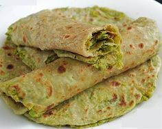 Green peas parathas Ingredients: ½ cup whole wheat flour ½ cup boiled green peas 1 tsp chopped green chilies 1 tbsp low fat curds 1/8 tsp carom seeds(ajwain) Salt to taste Method:  •	Puree the green peas into a smooth paste using 1 tbspn of water in a blender •	Combine all the ingredients and knead into a soft dough without using any water •	Roll out the dough into parathas •	Cook each paratha on a tawa until both sides are golden brown, using a little oil •	Serve hot