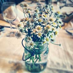 Mismatched mason jars, and vintage-inspired glassware each held a single variety of flower at this wedding reception at Sevens Restaurant at the base of peak 7 at the Breckenridge Ski Resort. http://petalandbean.com