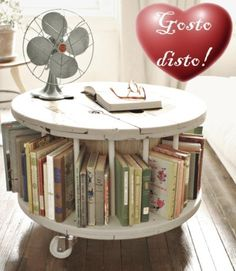 Vintage Interiors: How to do Shabby Chic Sustainably - Eluxe Magazine : Shabby Chic round coffee table bookshelf, vintage furniture, repurposed Diamond in the spaces for a rolling liquor coffee table Wooden Cable Reel, Wooden Cable Spools, Wood Spool, Diy Cable Spool Table, Cable Spool Ideas, Cable Reel Table, Wooden Spool Tables, Shabby Chic Furniture, Vintage Furniture