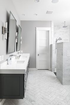 Grey never goes out of style, especially when done right. This clean minimal designed luxury master Grey Bathroom Cabinets, Marble Bathroom Floor, White Marble Bathrooms, Gray And White Bathroom, Yellow Bathrooms, Bathroom Renos, Bathroom Flooring, Bathroom Renovations, Bathroom Ideas