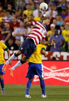 LANDOVER, MD - MAY 30: Clint Dempsey #8 of USA heads the ball against Brazil during an International friendly game at FedExField on May 30, 2012 in Landover, Maryland.