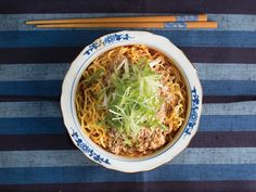 A fortified chicken stock, loaded with ground pork and sesame, serves as the base for this aromatic chile-spiked ramen.