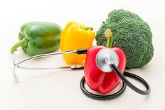 fresh organic vegetable and stethoscope on white background healthy