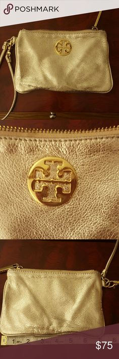 Genuine Tory Burch gold wristlet Scratch on the hardware in picture 2 Tory Burch Bags Clutches & Wristlets