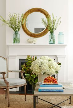 A large coffee table can become a huge block of dark wood that weighs down a room. Try taking a few beautiful art books down off the shelf and using them to break up table's surface. The room will feel lighter and brighter and you'll likely enjoy your books more, too. Design by Lynn Morgan   - HouseBeautiful.com