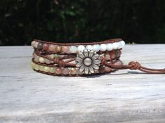 Reminds me of the beach and summer!   https://www.etsy.com/listing/164371439/flower-child-boho-chic-wrap-bracelet-3